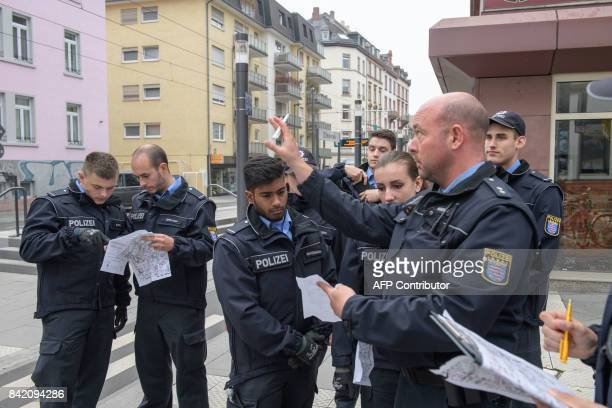 Police officers control if the residents have left their apartments as evacuation measures are under way in Frankfurt am Main western Germany on...
