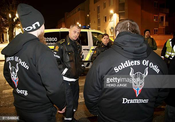 Police officers control members of the socalled Soldiers of Odin volunteer street patrol as they patrol through the streets of Drammen Norway on...