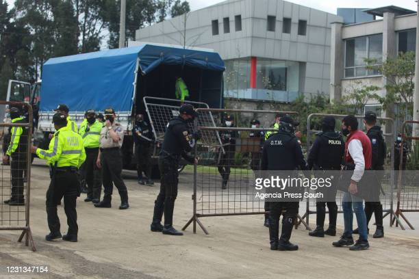 Police officers control the access of persons at Legal Medicine after deadly prison riots on February 23, 2021 in Cuenca, Ecuador. More than 50...
