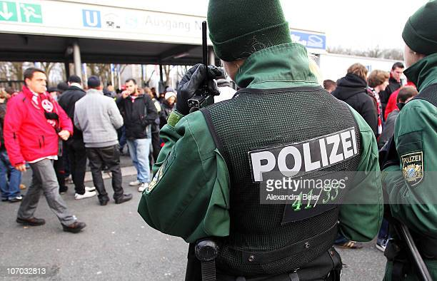 Police officers control the entrance of the Nuremberg soccer stadium before a Bundesliga match between 1 FC Nuernberg and 1 FC Kaiserslautern at Easy...