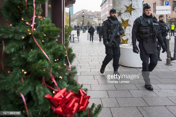 Police officers control the streets near the Christmas market where the day before a man shot 14 people killing at least three on December 12 2018 in...