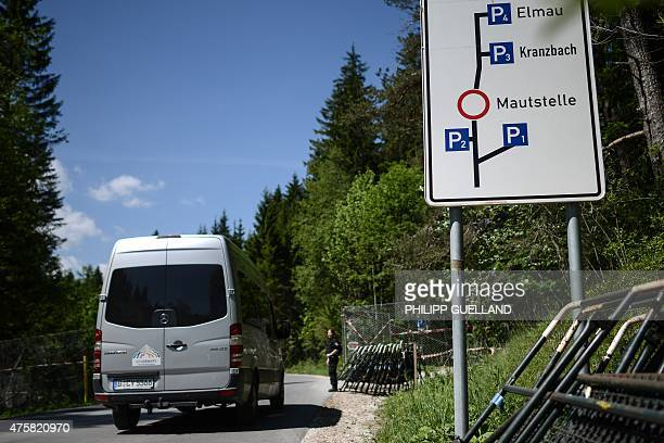 Police officers control vehicles at the gate of the perimeter fence that surrounds Elmau castle on June 4, 2015 in Klais near Kruen, southern...