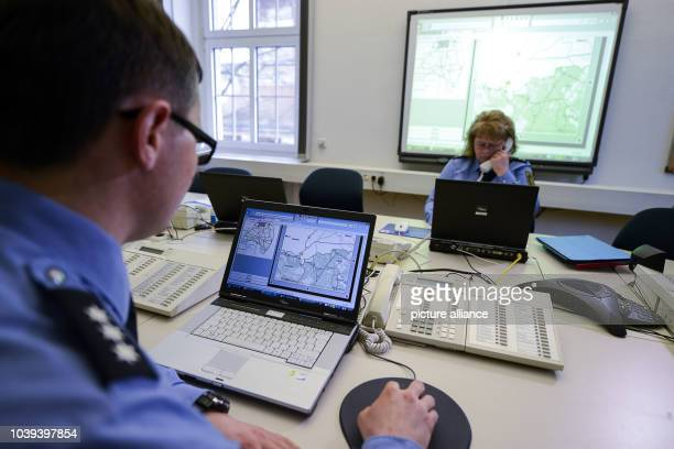 Police officers coordinate the GermanPolish police exercise in the control and situation room of the police authority in Goerlitz Germany 28 January...