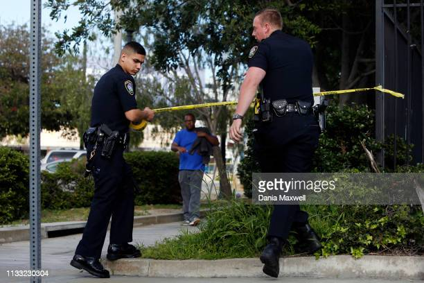 Police officers cordon off an area by Market Street in Inglewood where two officers were shot on March 27 in Los Angeles, California.