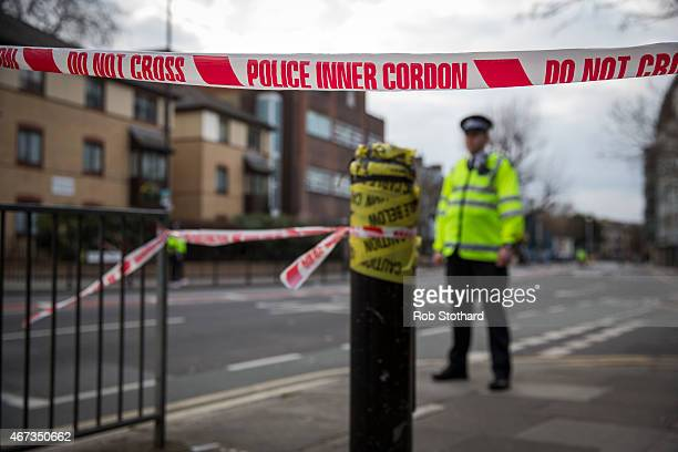 Police officers cordon off an area of the site of an unexploded World War Two bomb on March 23 2015 in Southwark England Over 1000 homes in the south...