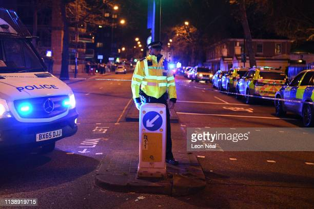 Police Officers cordon off Regents Park Mosque following a nearby fatal stabbing on March 28 2019 in London England Police are working at the scene...