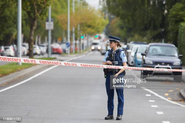 Police officers cordon off the area after gunmen attacked the two mosques and fired multiple times during Friday prayers in Christchurch New Zealand...