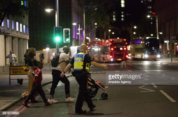 Police officers cordon off the area around London Bridge central London after reports of pedestrians being hit by a white van on London Bridge in...