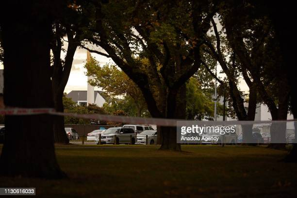 Police officers cordon off the area as they inspect the Al Noor Mosque the shooting site after gunmen attacked the two mosques and fired multiple...