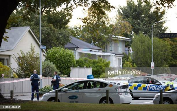 Police officers cordon off the area as they take security measures around the shooting site after gunmen attacked the two mosques and fired multiple...