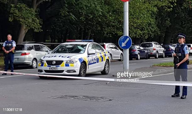 Police officers cordon off the area close to the mosque after a gunman filming himself firing at worshippers inside in Christchurch on March 15 2019...