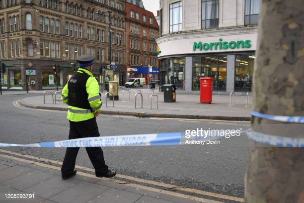 Police officers cordon off the area outside a Morrisons store following a reported stabbing at Manchester Piccadilly Gardens on February 10, 2020 in...