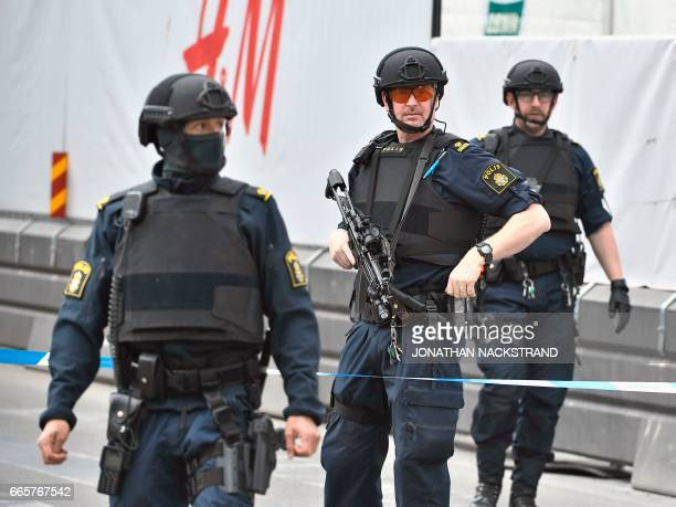 Police officers cordon off the scene where a truck crashed into the Ahlens department store at Drottninggatan in central Stockholm April 7 2017 News...