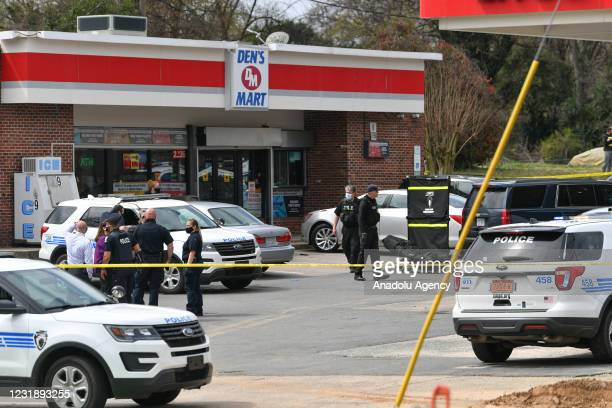 Police officers cordon the area after US Marshalls shot and killed a man who was a suspect at a gas station in Charlotte, North Carolina, United...