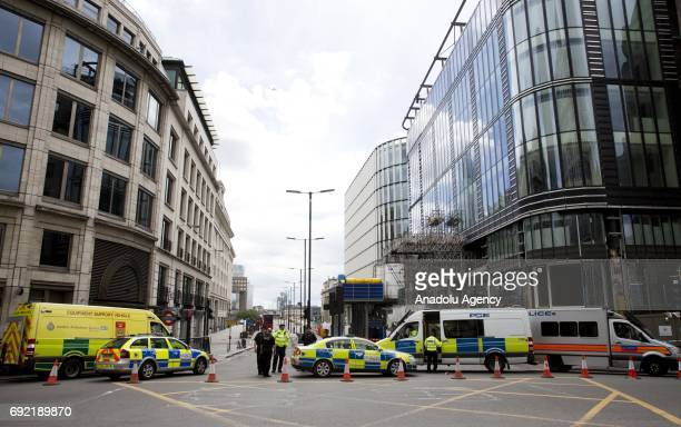 Police officers cordoned off London Bridge following last night terror attack at London Bridge and Borough Market central London where seven people...