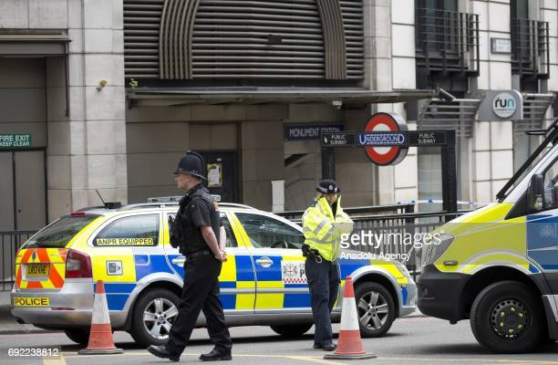 Police officers cordoned off the north side of London Bridge by Monument Underground Station following last night terror attack at London Bridge and...