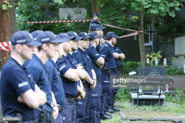 Police officers defending the entrance to the cemetery are seen in Gdansk Poland at the Srebrzysko cemetery on 14 May 2018 The prosecutor's office...