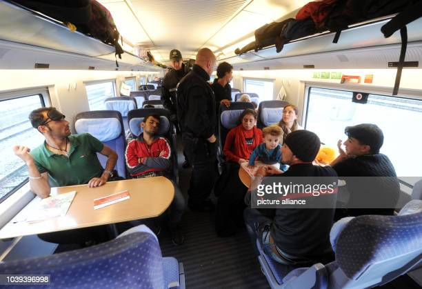 Police officers demand that traveling Syrian refugees Bezhad Ahmed Ghandy Ahmed Hewa Mano Sipan Sherin Melek and Amin Ahmed leave the train in...