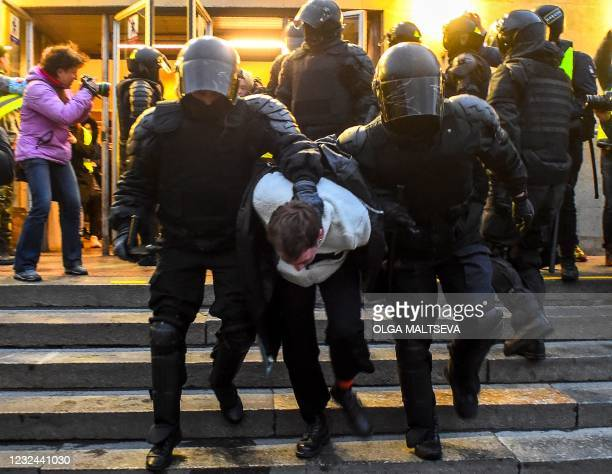 Police officers detain a protester during a rally in support of jailed Kremlin critic Alexei Navalny, in central Saint-Petersburg on April 21, 2021....