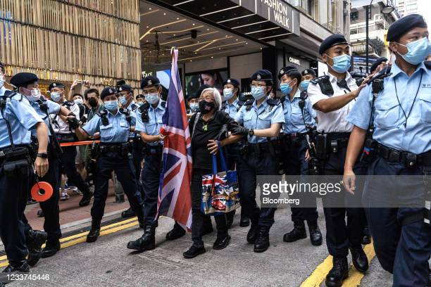Police officers detain Alexandra Wong, a protester known as Grandma Wong who attended rallies over the course of Hong Kong's unrest last year,...