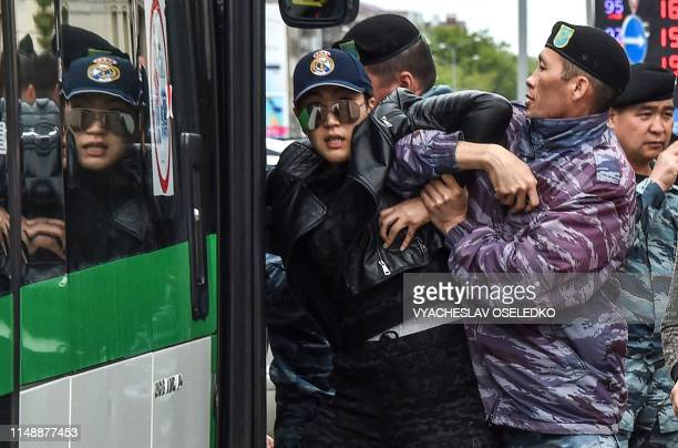 Police officers detain an opposition supporter on June 10 2019 in NurSultan a day after Kazakhstan's presidential elections Kazakhstan elected the...