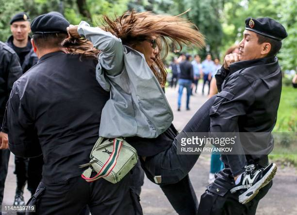 Police officers detain an opposition supporter on June 10 2019 in Almaty a day after Kazakhstan's presidential elections Kazakhstan elected the...