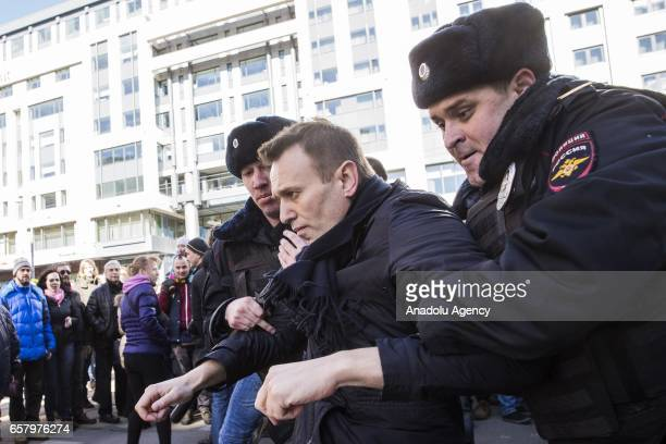 Police officers detain anticorruption campaigner and opposition figure Alexei Navalny during an opposition rally on March 26 2017 in Moscow