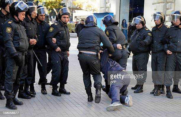 Police officers detain one of the opposition activists during an unauthorized rally to demand the resignation of President Ilham Aliyev at the...