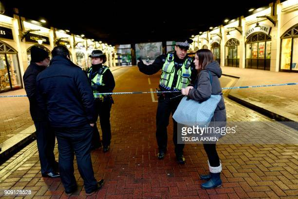 Police officers direct pedestrians around a cordon at Charing Cross Station in central London on January 23 2018 after a gas leak closed The Strand...