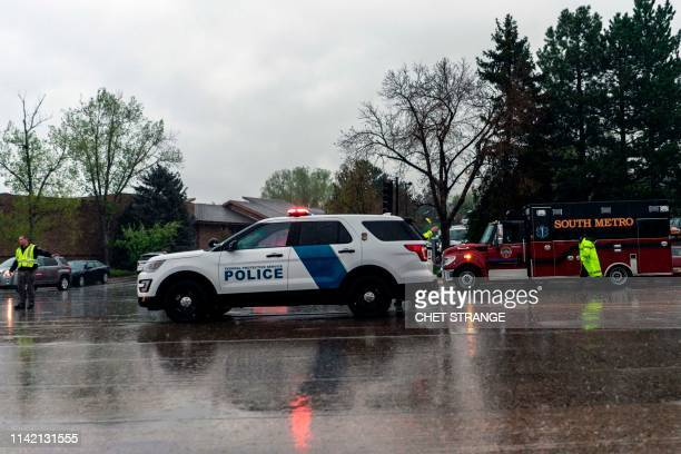 Police officers direct traffic after a shooting at the Recreation Center at Northridge in Highlands Ranch at the STEM School Highlands Ranch Colorado...