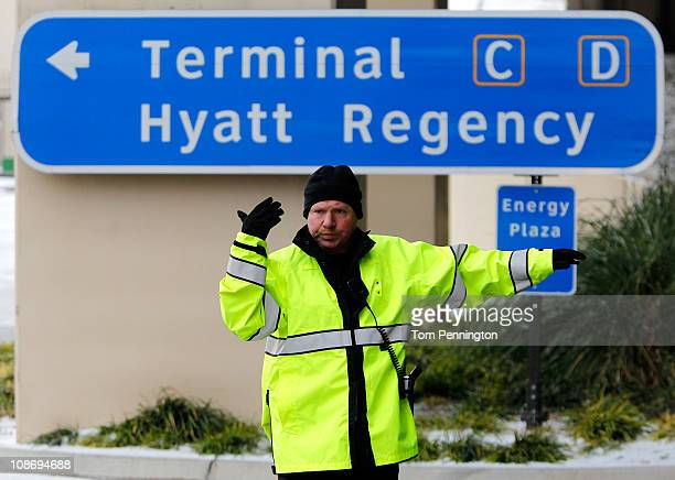 Police officers direct traffic after access roads to the airline terminals were closed at DFW International Airport on February 1 2011 in Dallas...