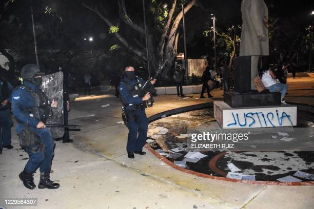 Police officers disperse a protest against the murder of a woman at a square near the City Hall in Cancun Quintana Roo State Mexico on November 9...