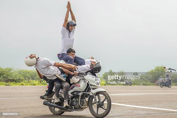 Police officers display their skills on motorcycles during rehearsal for the Indian Independence Day celebration in Ajmer Rajasthan India