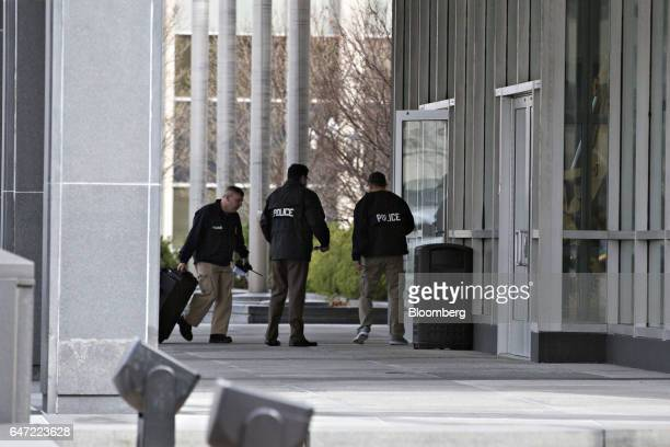 Police officers enter Caterpillar Inc headquarters in Peoria Illinois US on Thursday March 2 2017 Caterpillar Inc shares headed for the steepest...