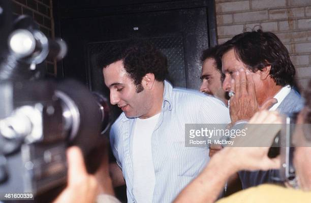 Police officers escort American accused serial killer David Berkowitz known as the Son of Sam into the 84th precinct station New York New York August...