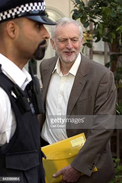 Police officers escort Labour leader Jeremy Corbyn from his home on June 28 2016 in London England Mr Corbyn is facing increased calls to resign as...