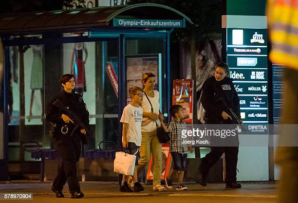Police officers escort people out of the Olympia Einkaufzentrum shopping mall on July 22 2016 in Munich Germany According to reports nine people have...