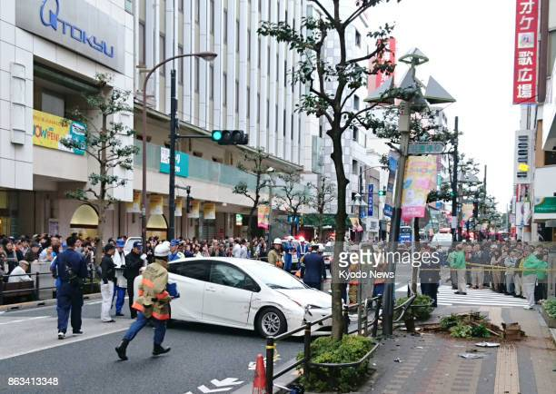 Police officers examine the accident site where a car rammed into pedestrians in front of a department store near JR Kichijoji Station in Tokyo on...
