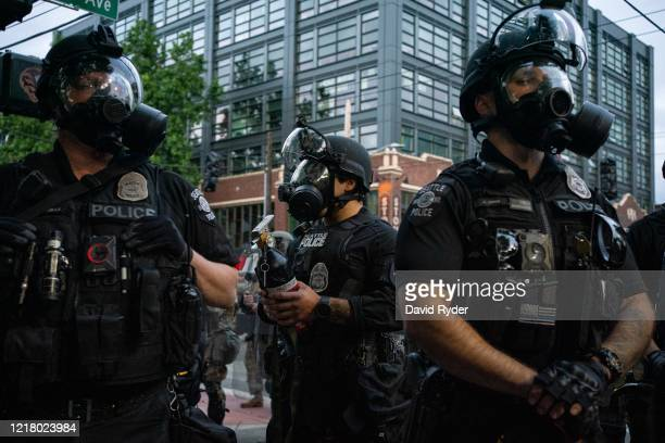 Police officers face off with demonstrators near the Seattle Police Departments East Precinct on June 6, 2020 in Seattle, Washington. This is the...