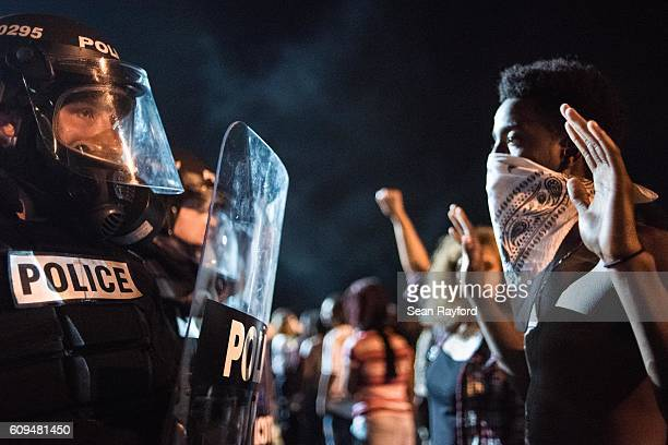 Police officers face off with protesters on the I85 during protests in the early hours of September 21 2016 in Charlotte North Carolina The protests...