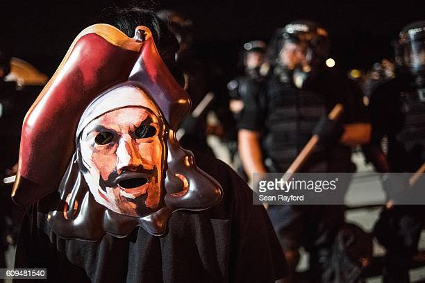 Police officers face off with protestors on the I85 during protests in the early hours of September 21 2016 in Charlotte North Carolina The protests...