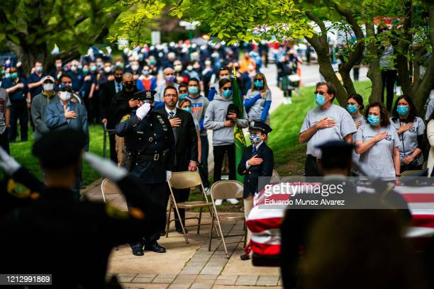 Police officers family and residents pay their respects during the funeral of Glen Ridge Police Officer Charles Roberts after he passed away from the...