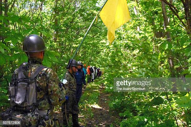 Police officers fire fighters and Japan Ground SelfDefense Force members continue searching of missing 7yearold Yamato Tanooka in the mountain on...