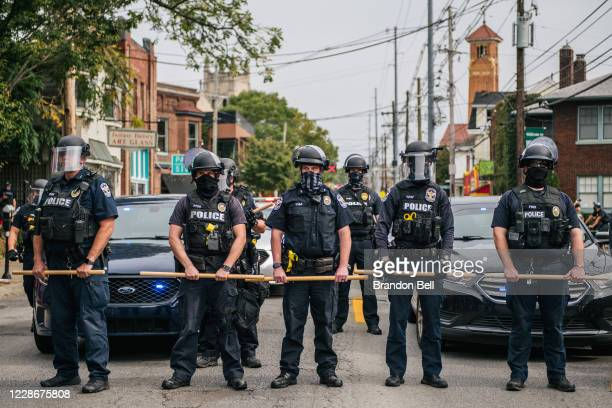 Police officers form a line during protests on September 23, 2020 in Louisville, Kentucky. Protesters marched in the streets after a Kentucky Grand...