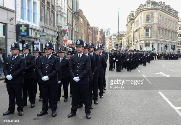 Police officers from across the country as well as thousands of Londoners gather to pay respect to PC Keith Palmer who was killed outside the Palace...