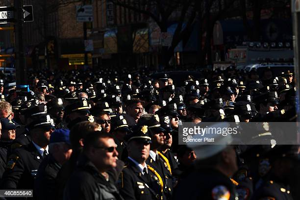 Police officers from around the country gather outside of Christ Tabernacle Church for the funeral of slain New York City Police Officer Rafael Ramos...