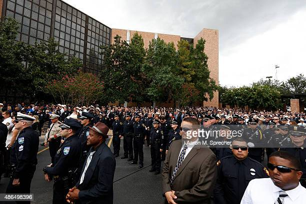 Police officers from around the state gather around following the funeral for Harris County Sheriff's Deputy Darren Goforth at Second Baptist Church...