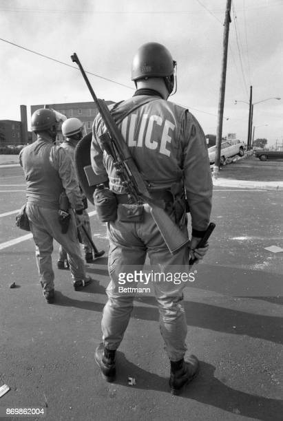 Police officers from Dover NJ were among those who moved into Asbury Park NJ to try to quell looting and firebombing These officers are equipped with...