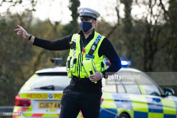 Police officers from Dyfed-Powys Police force speak to motorists travelling along the A477 from Carmarthenshire to Pembrokeshire during Wales'...