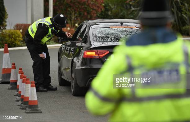 "Police officers from North Yorkshire Police stop motorists in cars to check that their travel is ""essential"", in line with the British Government's..."